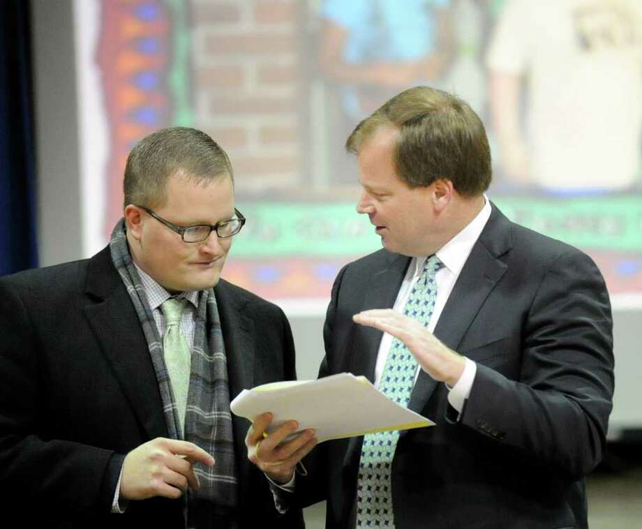 Greenwich Board of Education member Steven Anderson, right, speaks with the school district's business administrator, Ben Branyan, during the meeting at New Lebanon School in Byram, Thursday night, Feb. 23, 2012. Photo: Bob Luckey / Greenwich Time