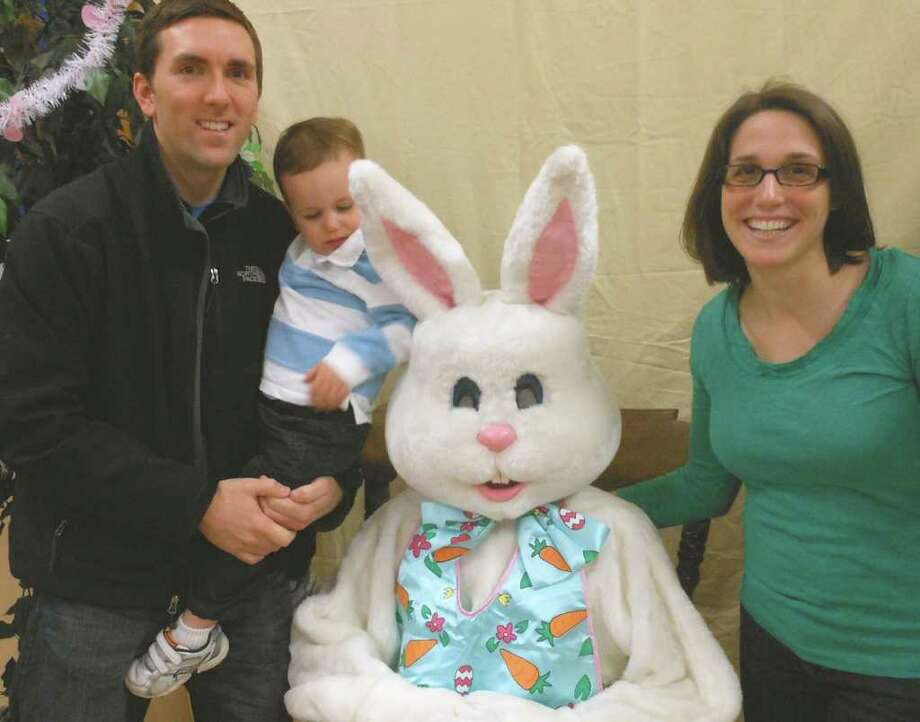 Noiel, Hunter and Lauren Brill pose for a picture with the Easter Bunny at Grace United Methodist Church on Saturday. Photo: Mike Lauterborn / Fairfield Citizen contributed