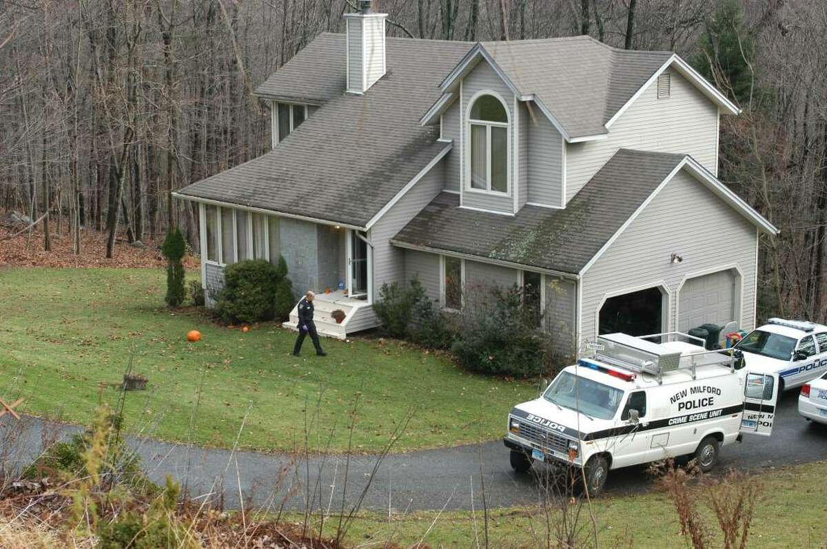 Police work at the home on Cortland Drive in New Milford home where 41-year-old Neil Fergus allegedly stabbed his estranged wife and attacked his mother-in-law Saturday afternoon. Catherine Fergus, also 41, was in stable condition at Danbury Hospital Sunday. Neil Fergus will be arraigned in court Monday.