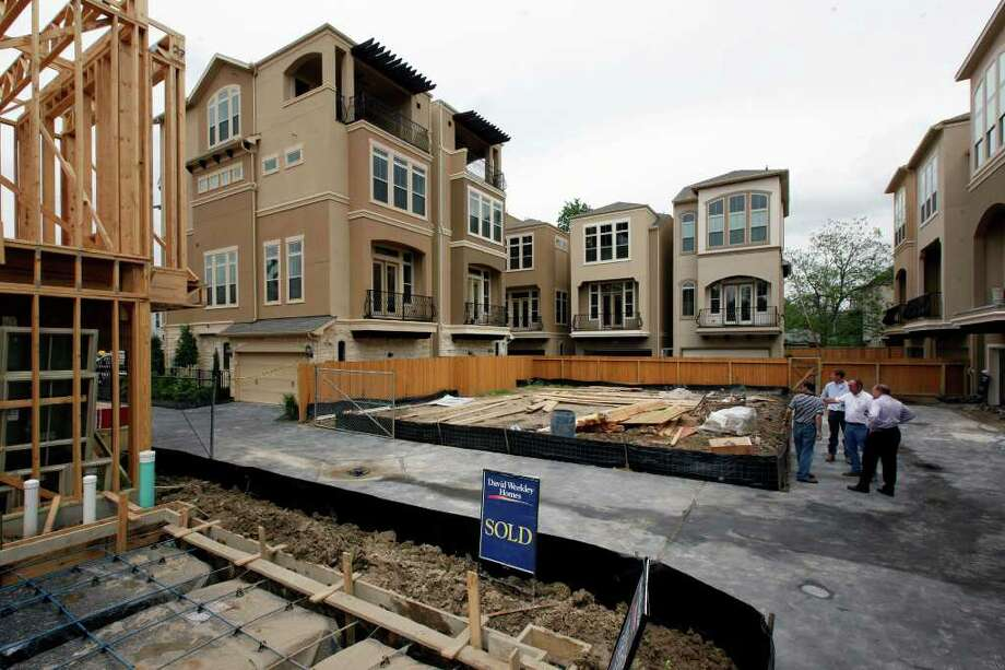 Washington Court, a group of detached family residences by Weekley Homes, is shown under construction on Friday in the Rice Military neighborhood. The city is looking to revise its Chapter 42 regulations on development. Photo: TODD SPOTH / © TODD SPOTH 2012