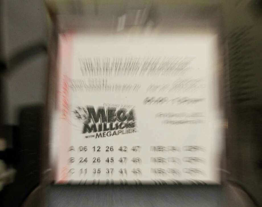 A San Antonio resident is $4 million richer after purchasing a winning Mega Millions ticket for Tuesday's drawing, according to the Texas Lottery's website. Photo: AP
