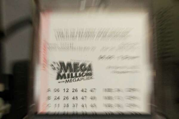 A Mega Millions jackpot lotto ticket is printed out for a customer Thursday, March 29, 2012, in Indianapolis.