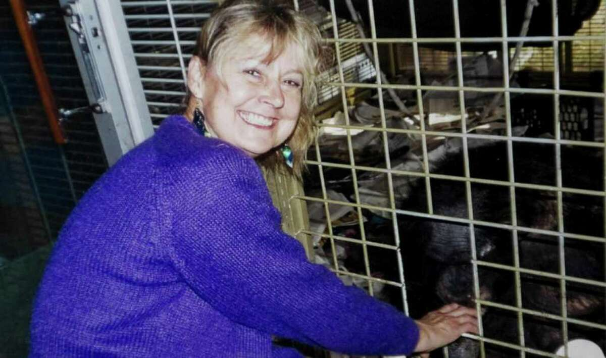 Charla Nash in a 2007 photo next to the cage with the chimpanzee Travis. Travis mauled Nash in February 2009 leaving her without any hands or eyes. Nash had a full face transplant in May at Brigham and Women's Hospital in Boston.