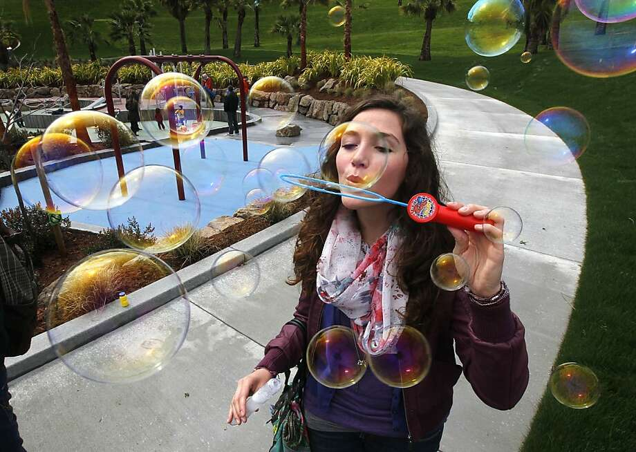 Miriam Eberspächer blows soapy bubbles at the grand opening of the Helen Diller Playground at Dolores Park in San Francisco, Calif. on Saturday, March 31, 2012. Photo: Paul Chinn, The Chronicle