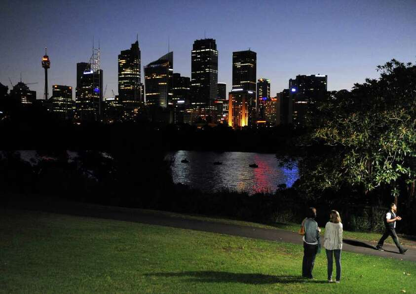 The Sydney skyline is illuminated shortly before the start of the 6th annual Earth Hour on March 31,