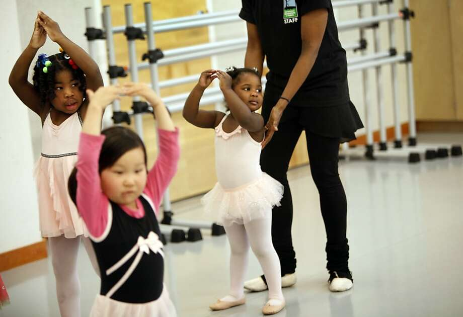Zhyeema Brown, 3, gets some help from instructor Michelle Handberry in pre-ballet class at the Harvey Milk Center for the Arts in San Francisco, Calif., Saturday, March 24, 2012.  Zhyeema and her sister are homeless and are part of a new effort to get kids in shelters involved in activities in the parks and recreation department. Photo: Sarah Rice, Special To The Chronicle