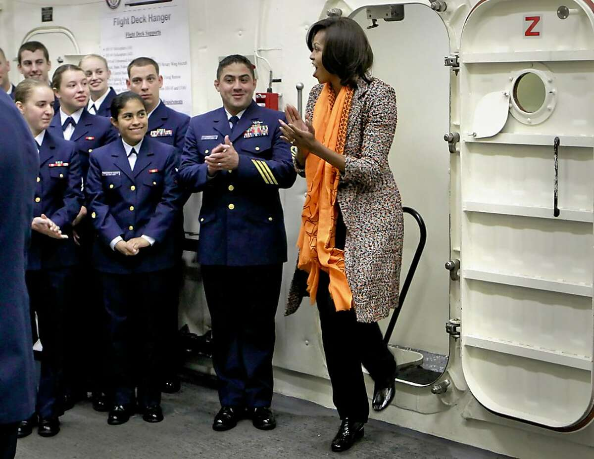 First Lady Michelle Obama greets the crew aboard the ship, as she helps to commission the United States Coast Guard Cutter Stratton on Coast Guard Island, on Saturday March 31, 2012, in Alameda, Ca.