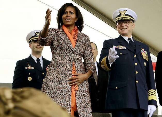First Lady Michelle Obama joins U.S. Coast Guard Admiral Robert J. Papp (right) as she helps commission the United States Coast Guard Cutter Stratton on Coast Guard Island, on Saturday March 31, 2012, in  Alameda, Ca. Photo: Michael Macor, The Chronicle