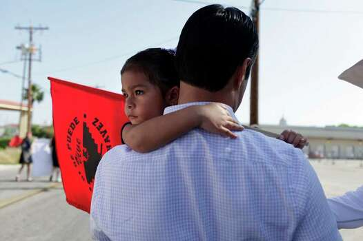 Mayor Julian Castro carries his daughter, Carina Castro, 3, during the Cesar E. Chavez March for Justice in San Antonio on Saturday, March 31, 2012. Photo: Lisa Krantz, SAN ANTONIO EXPRESS-NEWS / SAN ANTONIO EXPRESS-NEWS