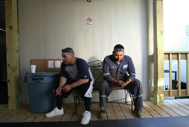 METRO -- Jose Tapia, 28, left, and Jose Pineda, 27, of Laredo, wait for their accommodations at the