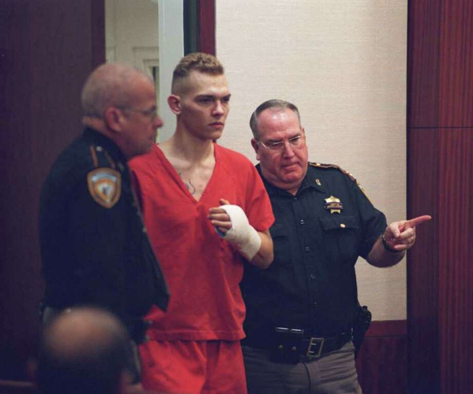 Robert Gene Will II says he couldn't have killed a Harris County officer because Will's hands were tied behind his back. Photo: Ben DeSoto / Houston Chronicle