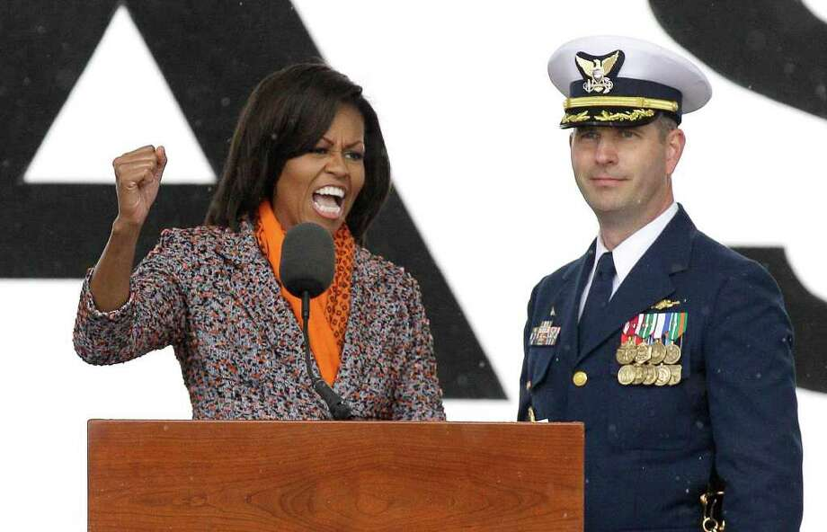 First Lady Michelle Obama, left, speaks forcefully at the a commissioning ceremony of the Coast Guard Cutter Stratton as U.S. Coast Guard Captain Charles Cashin, looks in Alameda, Calif., Saturday, March 31, 2012. Photo: Jeff Chiu, Associated Press / AP