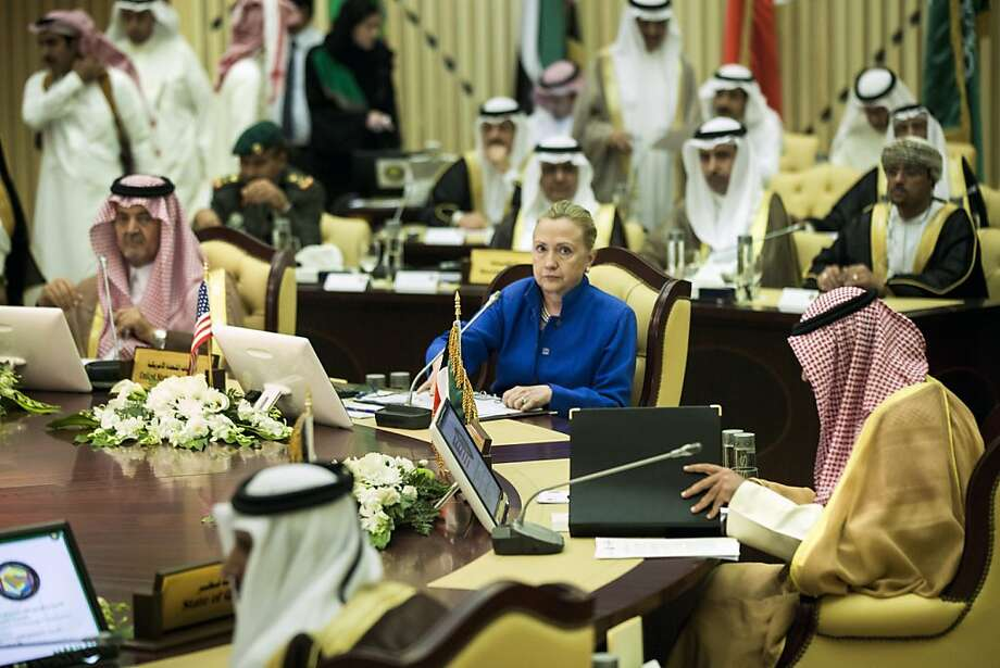 Saudi Foreign Minister Prince Saud Al-Faisal (L), US Secretary of State Hillary Clinton and Kuwaiti Foreign Minister Sheikh Sabah Khaled al-Hamad Al-Sabah and others wait for the start of the US- Gulf Cooperation Council forum at the Gulf Cooperation Council Secretariat begins on March 31, 2012 in Riyadh.  Secretary Clinton is visiting the region to speak with leaders about local and global issues including Iran as well as attend talks aimed at ending the violence by the Assad regime towards its citizens in Syria. Photo: Brendan Smialowski, AFP/Getty Images