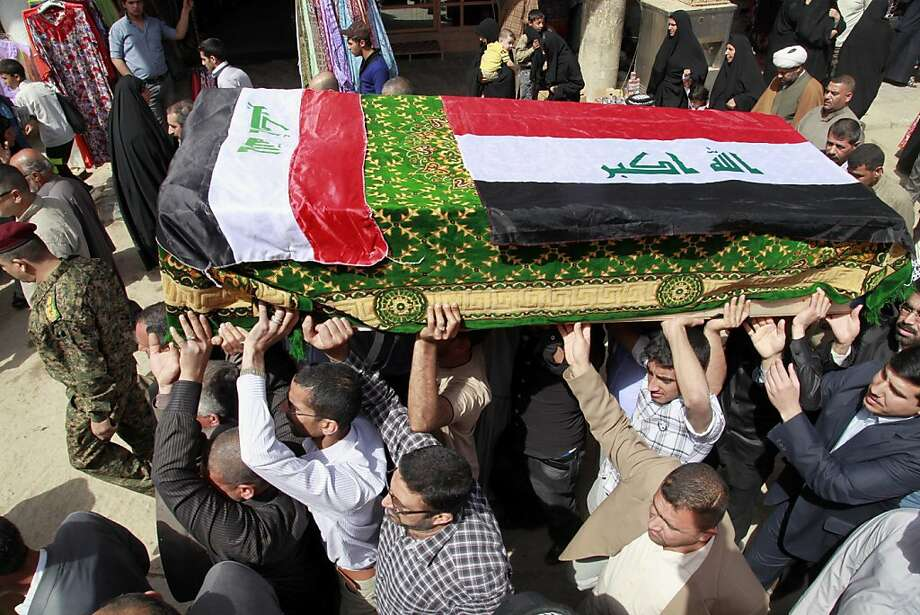 Mourners carry a coffin draped with Iraqi flags during the funeral procession for Shaima Alawadi in the Shiite holy city of Najaf, 100 miles (160 kilometers) south of Baghdad, Iraq, Saturday, March 31, 2012. Alawadi was an Iraqi-American woman found bludgeoned to death in her California home last week, with a threatening note left beside her body, was buried in her native Iraq on Saturday. Photo: Hadi Mizban, Associated Press