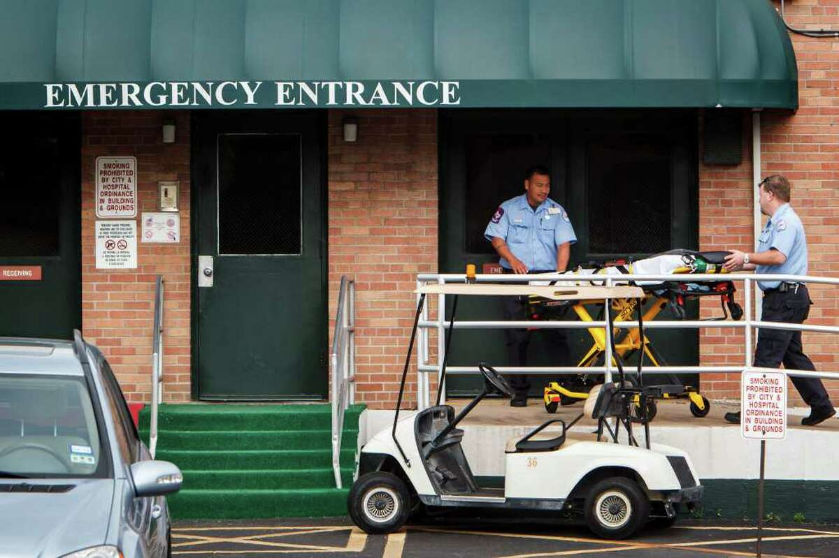 Paramedics wheel a stretcher into the Riverside General Hospital in the Third Ward, Thursday, March 29, 2012, in Houston. In the 50 years since desegregation, the former Houston Negro Hospital which was renamed Riverside in 1961 has struggled to compete in Houston, a city filled with health care options. After remaking itself in the 1980s as a substance abuse center, it now mostly on Medicare and Medicaid dollars that pay for very segregated but lucrative patient population: the mentally ill. ( Michael Paulsen / Houston Chronicle )