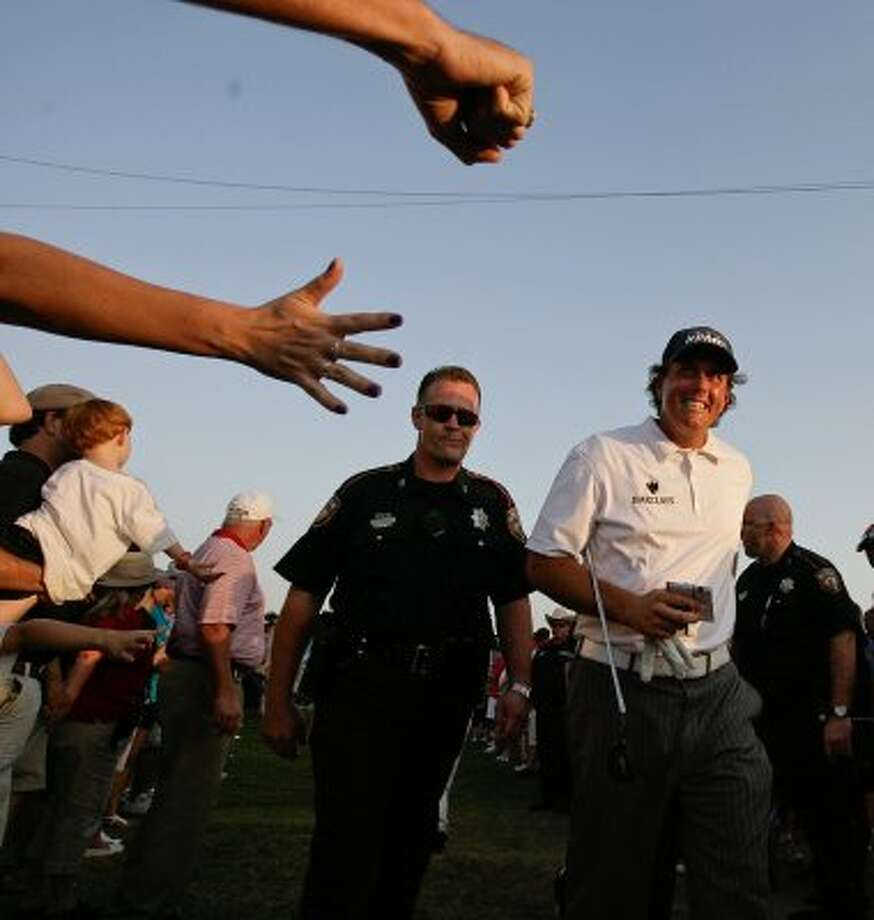 Phil Mickelson smiles to the crowd as he walks to the interview area after finishing the third round. Mickelson is tied for sixth place with a score of 205. (Nick de la Torre / Houston Chronicle)