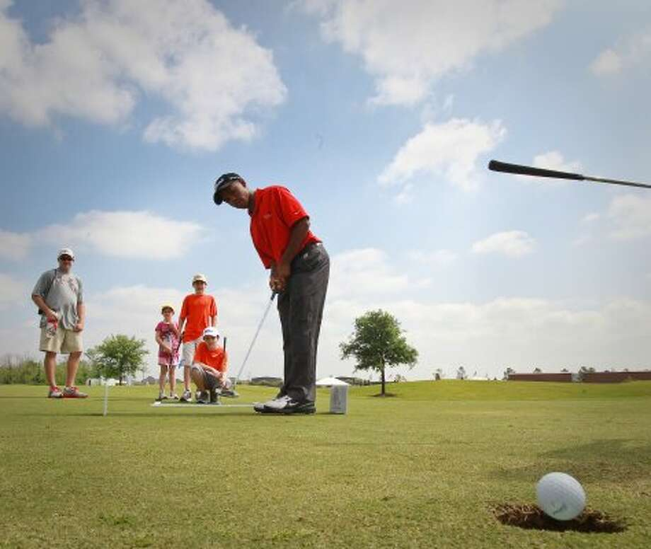Kennedy Richardson, 14, of Spring, makes a putt, he made 8 of 12, as he participates in the golf mini course promoting The First Tee at the Shell Houston Open. The First Tee is a youth development program dedicated to providing young people of all backgrounds an opportunity to develop, through golf and character education. (Nick de la Torre / Houston Chronicle)
