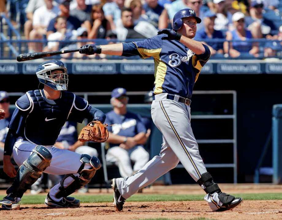 Milwaukee's Mat Gamel hits a grand slam against the Padres on Saturday. Photo: AP