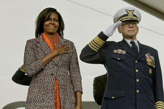 First Lady Michelle Obama joins U.S. Coast Guard Admiral Robert J. Papp in the pledge of Allegiance as she helps to commission the United States Coast Guard Cutter Stratton on Coast Guard Island, on Saturday March 31, 2012, in  Alameda, Ca. Photo: Michael Macor, The Chronicle