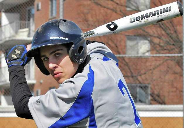 Albany catcher Collin Raimo swings a new composite bat before a game with Colonie High  Friday March 30, 2012.  All teams in New York are now required to use bats that conform to a new standard.  (John Carl D'Annibale / Times Union) Photo: John Carl D'Annibale / 00017027A