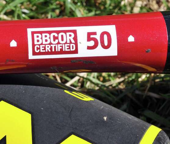 BBCOR certification logo on one of Colonie High's new composite bats at the school Friday March 30, 2012.  All teams in New York are now required to use bats that conform to this standard.  (John Carl D'Annibale / Times Union) Photo: John Carl D'Annibale / 00017027A