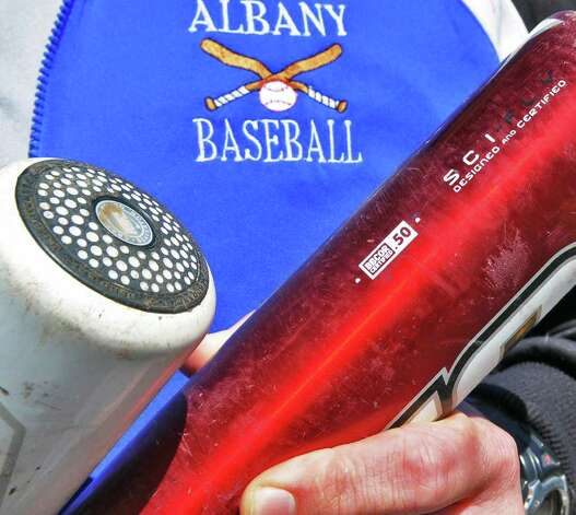 A pair of Albany High's new composite bats  before a game with Colonie High Friday March 30, 2012.  All teams in New York are now required to use bats that conform to a new standard.  (John Carl D'Annibale / Times Union) Photo: John Carl D'Annibale / 00017027A
