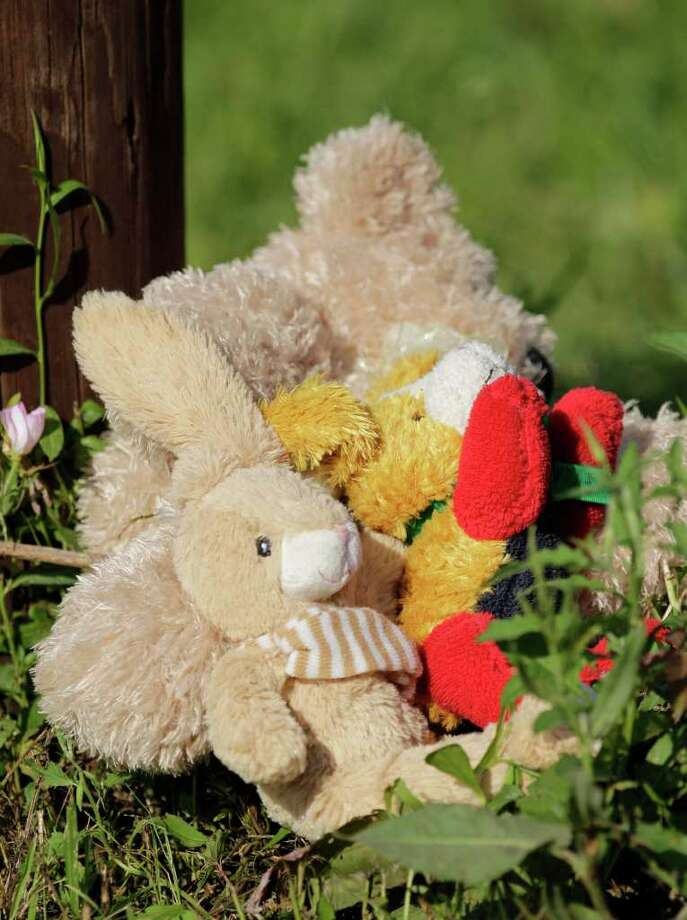 Toys are placed outside the Davis home as a memorial to Devon Davis. Photo: Melissa Phillip / © 2012 Houston Chronicle