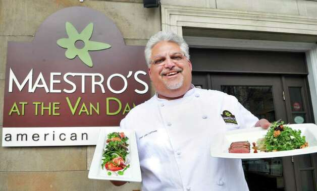Chef John LaPosta holds a couple of the lighter items that he is planning for the new spring menu at Maestro's at the Van Dam in Saratoga Springs Wednesday March 28, 2012.  (John Carl D'Annibale / Times Union) Photo: John Carl D'Annibale / 00016994A