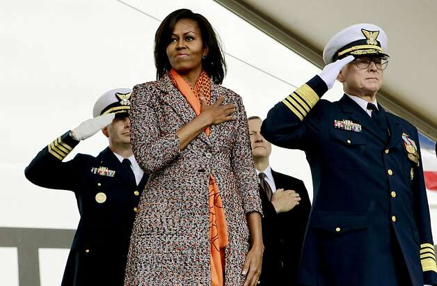 First Lady Michelle Obama joins U.S. Coast Guard Admiral Robert J. Papp, (right) to help commission the United States Coast Guard Cutter Stratton on Coast Guard Island, on Saturday March 31, 2012, in  Alameda, Ca. Photo: Michael Macor, The Chronicle