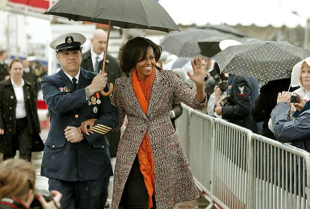 First Lady Michelle Obama is escorted to the stage by Command Senior Chief David Stephens as she helps to commission the United States Coast Guard Cutter Stratton on Coast Guard Island, on Saturday March 31, 2012, in  Alameda, Ca. Photo: Michael Macor, The Chronicle