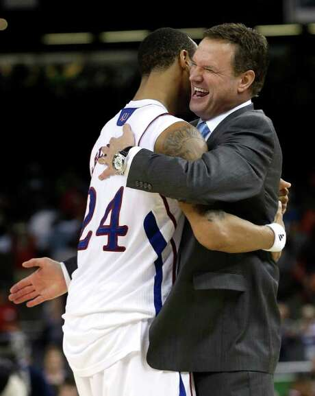 Coach Bill Self (right) is on the cusp of a second national title with Kansas. Photo: AP