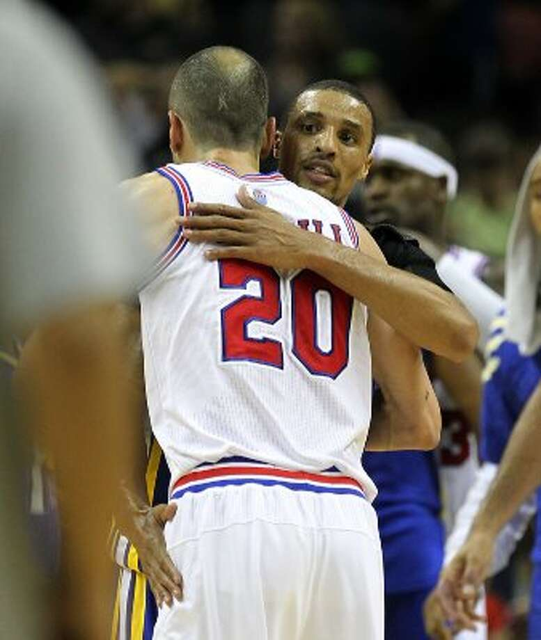 Spurs' Manu Ginobili (20) gets a hug from former teammate, current Indiana Pacer George Hill (03) at the end of their game at the AT&T Center on Saturday, Mar. 31, 2012. Spurs defeated the Pacers, 112-103. Kin Man Hui/Express-News. (San Antonio Express-News)