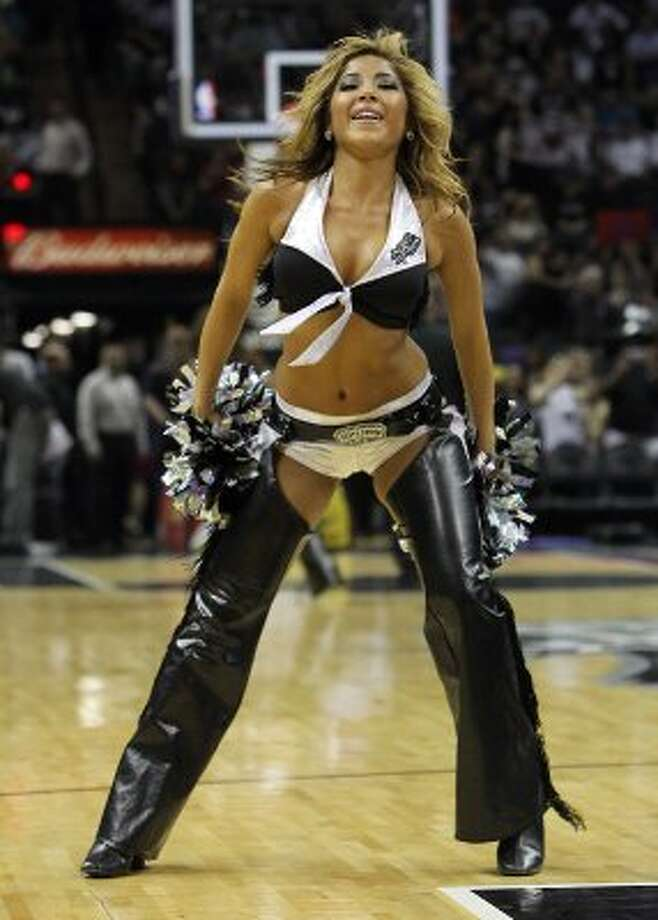 A Spurs Silverdancer performs before the start of the Spurs game against the Indiana Pacers at the AT&T Center on Saturday, Mar. 31, 2012. Kin Man Hui/Express-News. (San Antonio Express-News)