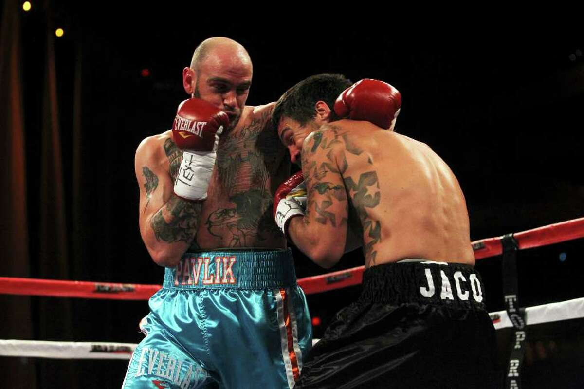 Kelly Pavlik (left) moves in on Aaron Jaco during their fight at the Top Rank Boxing matches at the Alamodome on March 31, 2012. Tom Reel/ San Antonio Express-News