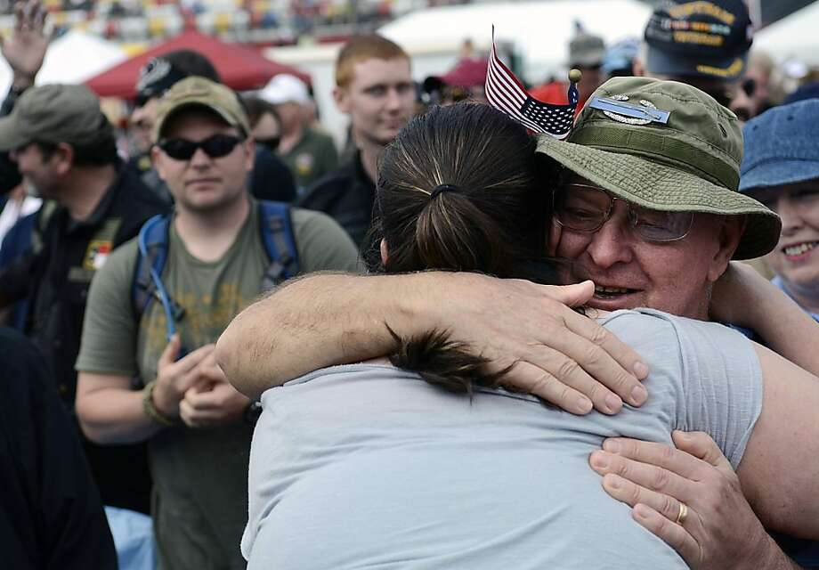 Vietnam veteran Tom Rhyne, of Stanfield, N.C., gets a hug from Sara Butner, of Winston-Salem, N.C., during the USO North Carolina Vietnam Veterans Homecoming Celebration, on Saturday, March 31, 2012, in Concord, N.C.. The USO of North Carolina and Charlotte Motor Speedway, with support from the North Carolina Association of Broadcasters, honored the service of Vietnam veterans with a special welcome home event at the Charlotte Motor Speedway.  (AP Photo/The Charlotte Observer, John D. Simmons) Photo: John D. Simmons, Associated Press