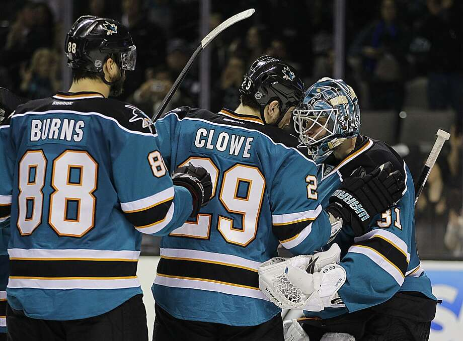 San Jose Sharks goalie Antti Niemi, right, is congratulated by teammates Ryane Clowe (29) and Brent Burns (88) after the defeat of the Dallas Stars at the end of an NHL hockey game Saturday, March 31, 2012, in San Jose, Calif. Photo: Ben Margot, Associated Press