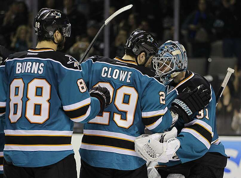 San Jose Sharks goalie Antti Niemi, right, is congratulated by teammates Ryane Clowe (29) and Brent