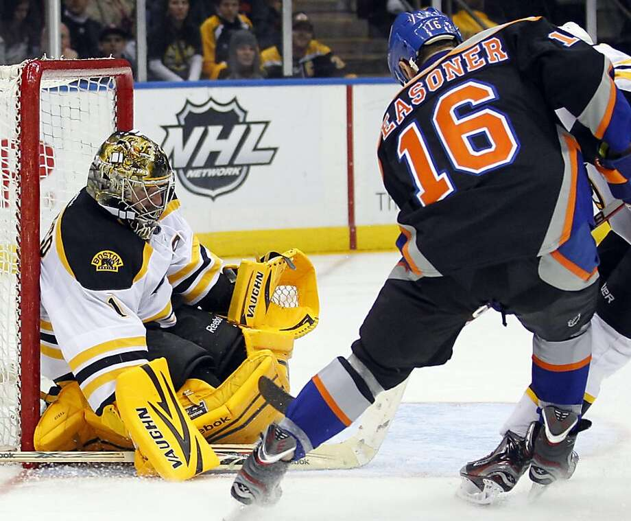 Boston Bruins goalie Marty Turco (1) makes a save on a shot by New York Islanders Marty Reasoner (16) during the second period of an NHL hockey game at the Nassau Coliseum in Uniondale, N.Y., Saturday, March 31, 2012. The Bruins won 6-3.P Photo/Paul J. Bereswill) Photo: Paul Bereswill, Associated Press
