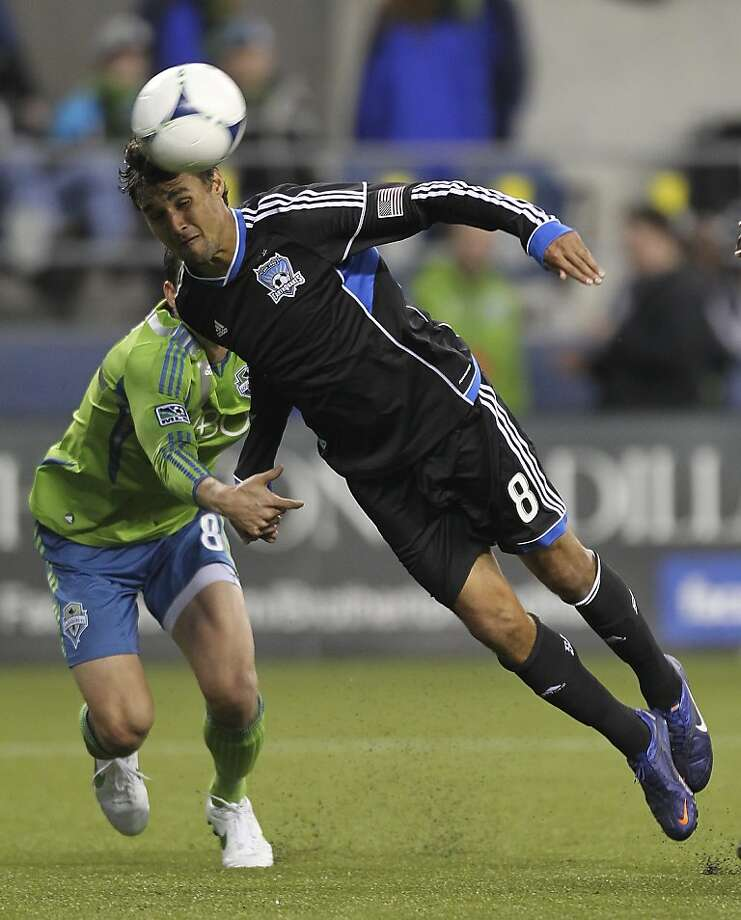SEATTLE - MARCH 31:  Chris Wondolowski #8 of the San Jose Earthquakes takes a shot against Marc Burch #8 of the Seattle Sounders at CenturyLink Field on March 31, 2012 in Seattle, Washington. (Photo by Otto Greule Jr/Getty Images) Photo: Otto Greule Jr, Getty Images