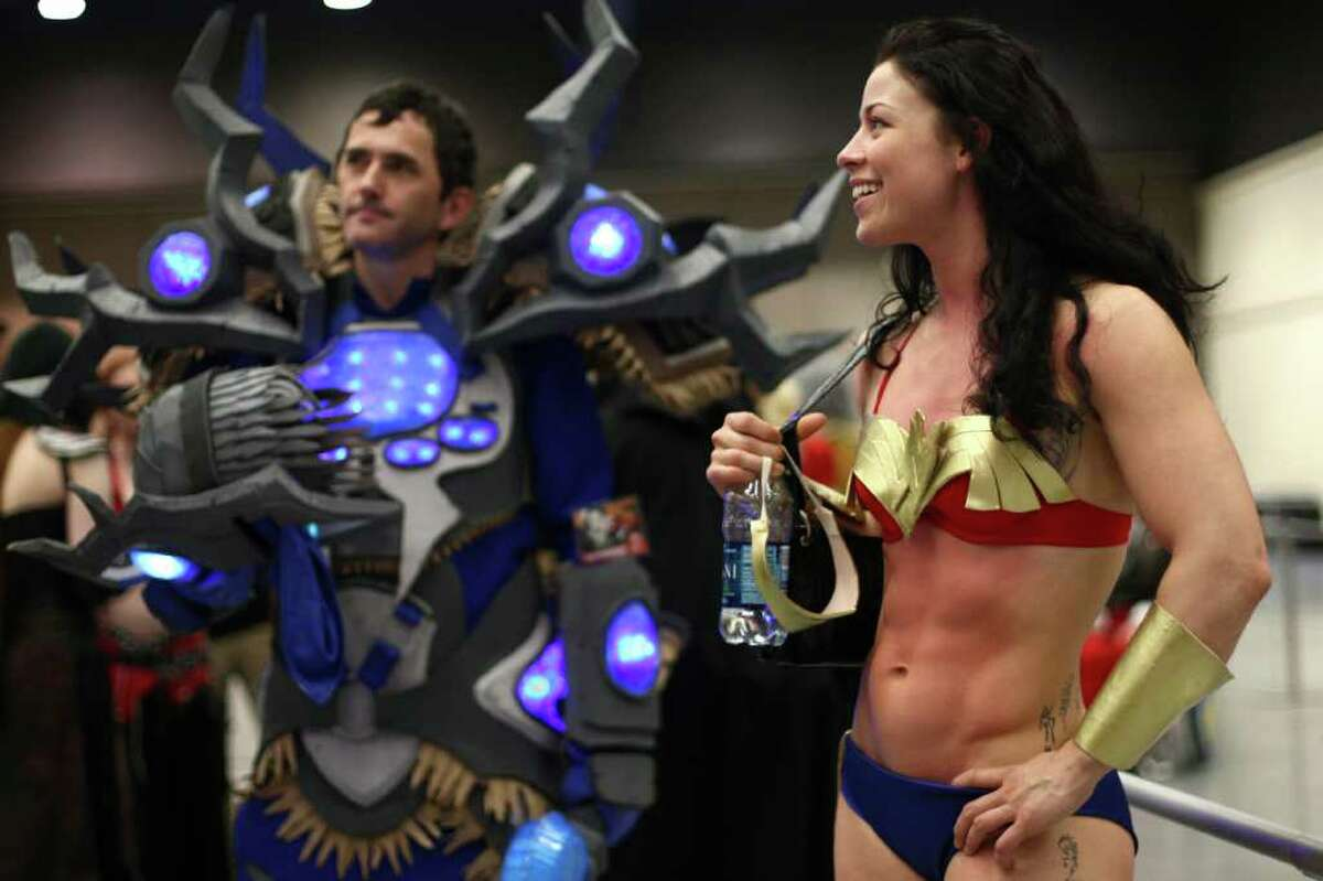 Elizabeth Rillera, dressed as Wonder Woman, waits backstage during the costume contest at Emerald City Comicon on Saturday, March 31, 2012. The annual comic book and pop culture convention is the largest such convention in the Pacific Northwest.