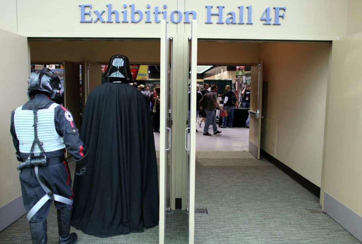 Darth Vader enters the main exhibition hall during Emerald City Comicon on Friday, March 30, 2012. The annual comic book and pop culture convention is the largest such convention in the Pacific Northwest.