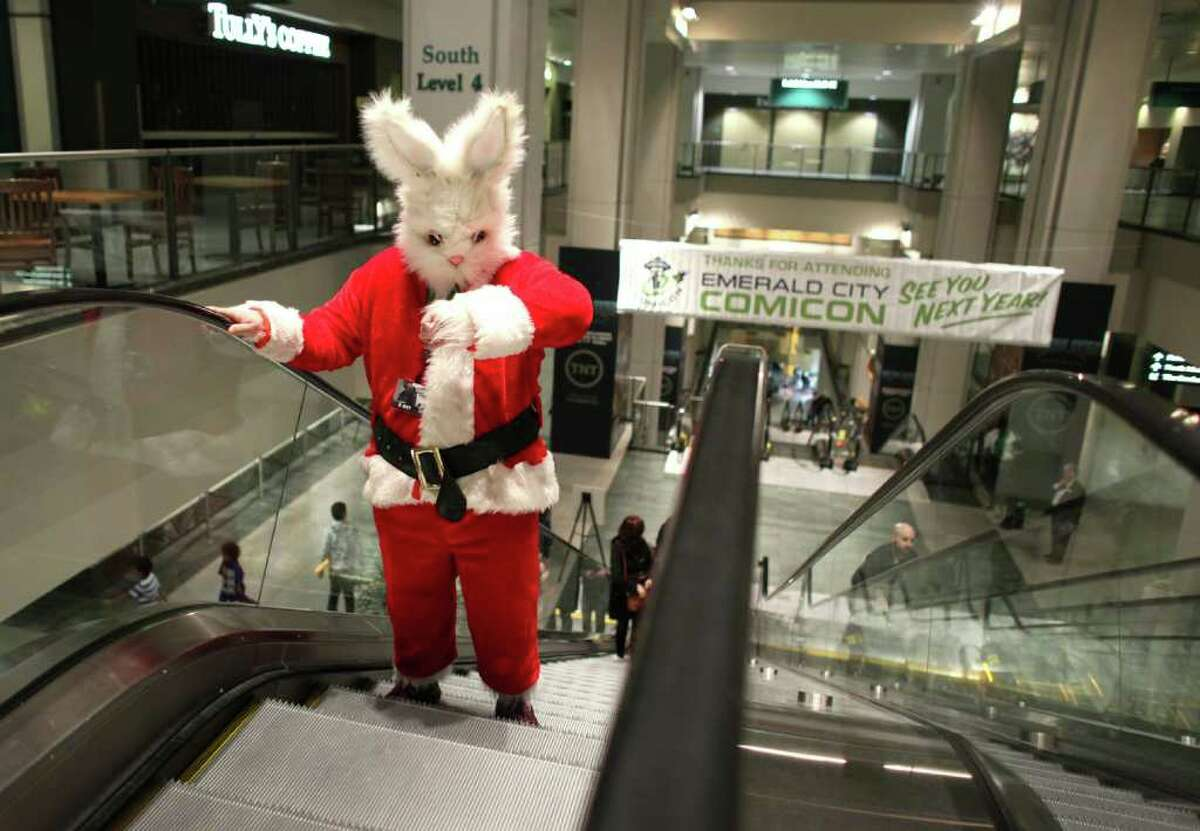 Sean Chew, dressed as a Santa bunny, rides the escalator during Emerald City Comicon on Saturday, March 31, 2012. The annual comic book and pop culture convention is the largest such convention in the Pacific Northwest.