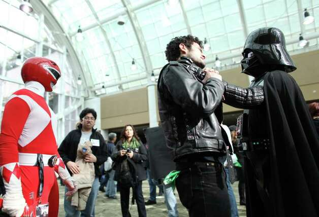 Darth Vader grabs hold of a fan during Emerald City Comicon on Friday, March 30, 2012. The annual comic book and pop culture convention is the largest such convention in the Pacific Northwest. Photo: JOSHUA TRUJILLO / SEATTLEPI.COM