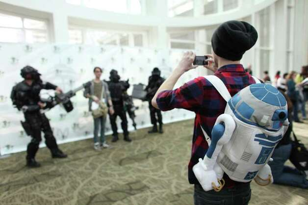 Steven Francis wears an R2D2 backpack as he takes a photo during Emerald City Comicon on Friday, March 30, 2012. The annual comic book and pop culture convention is the largest such convention in the Pacific Northwest. Photo: JOSHUA TRUJILLO / SEATTLEPI.COM