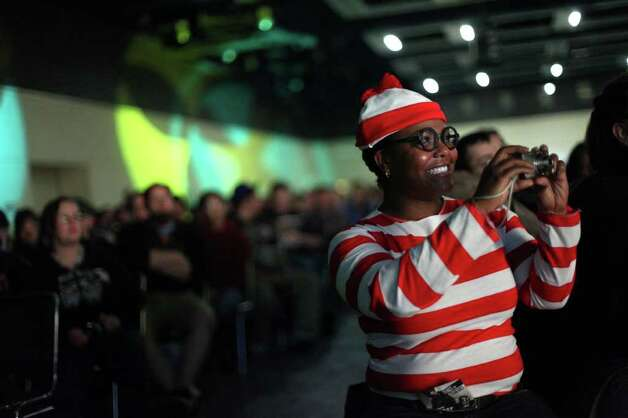 Nourisha Wells, dressed as Waldo, watches the costume contest during Emerald City Comicon on Saturday, March 31, 2012. The annual comic book and pop culture convention is the largest such convention in the Pacific Northwest. Photo: JOSHUA TRUJILLO / SEATTLEPI.COM