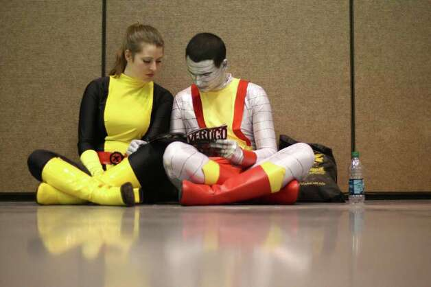 Lauren McLaren, left, dressed as Kitty Pryde, and Ryan Suter, dressed as Colossus, read a comic book during Emerald City Comicon on Saturday, March 31, 2012. The annual comic book and pop culture convention is the largest such convention in the Pacific Northwest. Photo: JOSHUA TRUJILLO / SEATTLEPI.COM