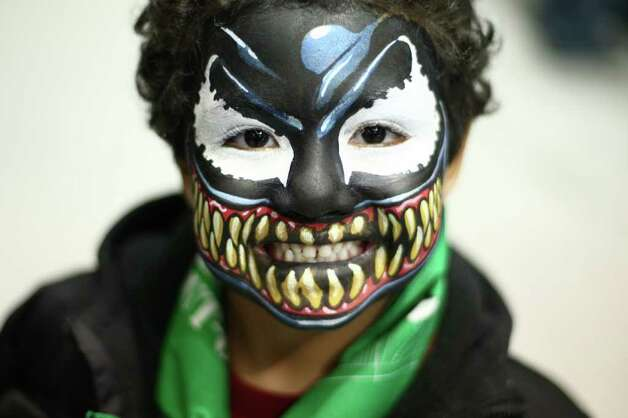 Mekai Williams, 4, shows off his face paint during Emerald City Comicon on Friday, March 30, 2012. The annual comic book and pop culture convention is the largest such convention in the Pacific Northwest. Photo: JOSHUA TRUJILLO / SEATTLEPI.COM