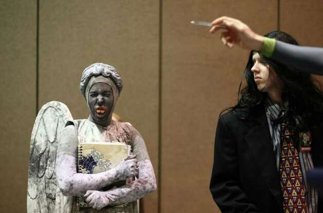 Competitors wait backstage during the costume contest at Emerald City Comicon on Saturday, March 31, 2012. The annual comic book and pop culture convention is the largest such convention in the Pacific Northwest. Photo: JOSHUA TRUJILLO / SEATTLEPI.COM