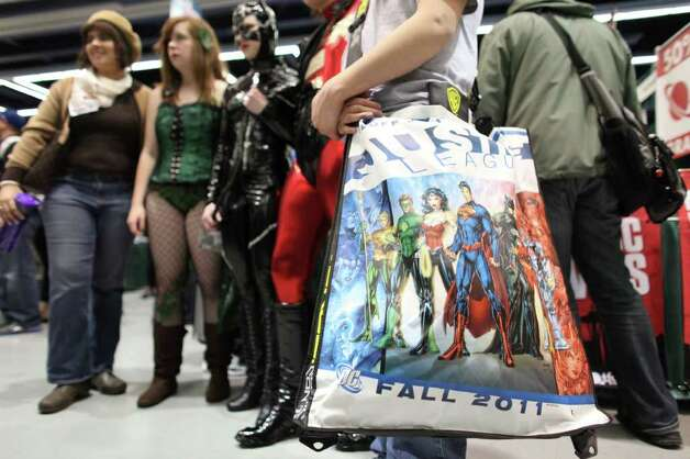 A cast of characters gathers together during Emerald City Comicon on Friday, March 30, 2012. The annual comic book and pop culture convention is the largest such convention in the Pacific Northwest. Photo: JOSHUA TRUJILLO / SEATTLEPI.COM