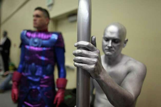 Silver Surfer Rick Ferguson readies his board during Emerald City Comicon on Saturday, March 31, 2012. The annual comic book and pop culture convention is the largest such convention in the Pacific Northwest. Photo: JOSHUA TRUJILLO / SEATTLEPI.COM